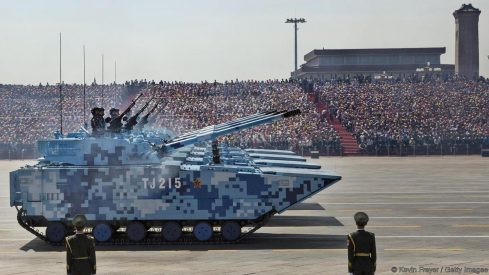 BEIJING, CHINA - SEPTEMBER 03: Chinese soldiers ride in tanks as they pass in front of Tiananmen Square and the Forbidden City during a military parade on September 3, 2015 in Beijing, China. China is marking the 70th anniversary of the end of World War II and its role in defeating Japan with a new national holiday and a military parade in Beijing. (Photo by Kevin Frayer/Getty Images)